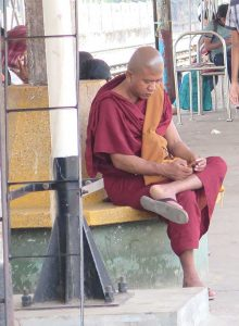 A monk uses a cell phone. Photo Victor Block